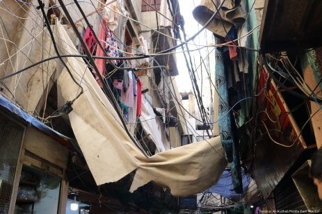 Chaotic maze of wires and sheets dangle over the narrow streets of Shatila.
