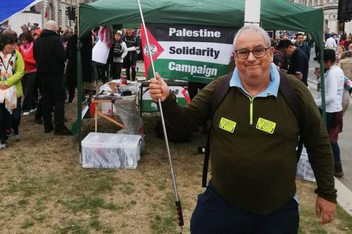Pro-Israel activist, Jonathan Hoffman can be seen at Parliament Square standing near the 'Palestine Solidarity Campaign' stall on 4 June 2019 [jhoffman1/Twitter]