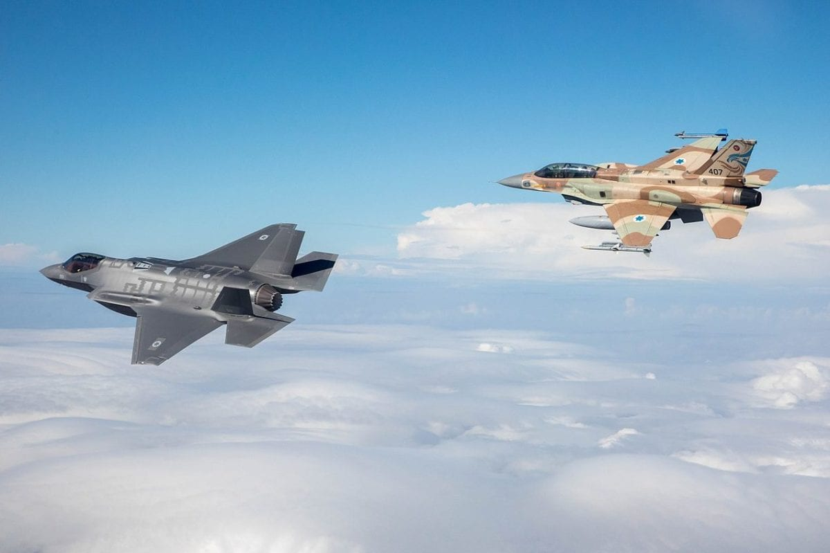 The Israeli Air Force's latest fighter jet - the F-35 [left] seen in flight along with an older F-16, on December 13, 2016 [Israeli Air Force / WikiMedia]