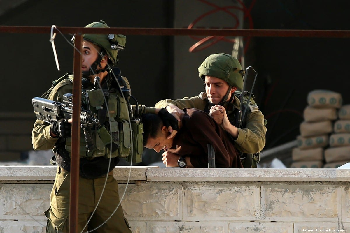 Israeli security forces arrest a Palestinian in the West Bank, on 15 December 2018 [Ayman Ameen/Apaiamges]