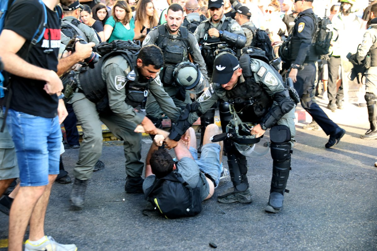 Israeli forces arrest a protester on 3 July 2019 [Oren Ziv/Anadolu Agency]