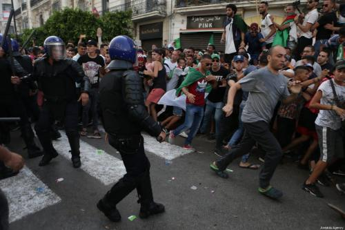 For the 21st Friday in a row, Algerians stage a demonstration demanding former regime officials to step down, in Algiers, Algeria on July 05, 2019. Image shows protestors clashing with Algerian security forces [Farouk Batiche / Anadolu Agency]