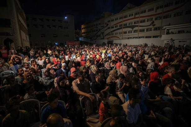 Palestinians arrive to watch a dance performance on the 20th Palestinian Festival celebrations in Gaza City, Gaza on 8 July 2019 [Ali Jadallah/Anadolu Agency]