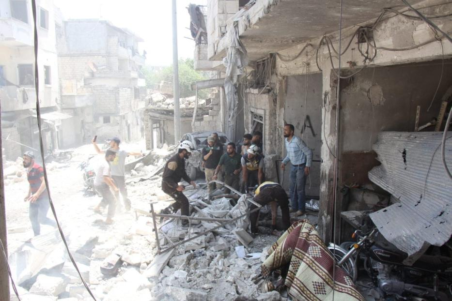 Civil defense team and locals carry out search and rescue works at the site around the collapsed buildings after warplanes of Assad regime forces and Russian forces hit the de-escalation zone, Jisr al-Shughur district of Idlib, Syria on 11 July 2019. [Bera Derwish - Anadolu Agency]