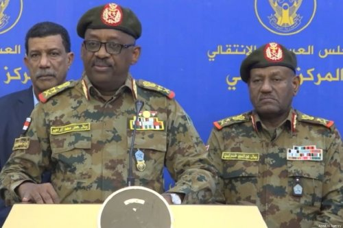 A screen grab captured from the statement broadcast live on state-run television shows General Jamal Omar (front), chairman of the ruling military council's Committee on Security and Defense, declares that it had foiled an attempted coup in Khartoum, Sudan on July 12, 2019 [AA / Anadolu Agency]