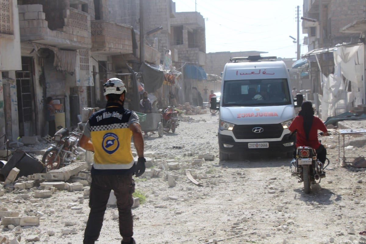 An ambulance arrives at the scene after airstrikes by Assad Regime and Russia's warplanes hit the de-escalation zone of Kafriya village in Idlib, Syria on 13 July, 2019 [Ahmet Weys/Anadolu Agency]