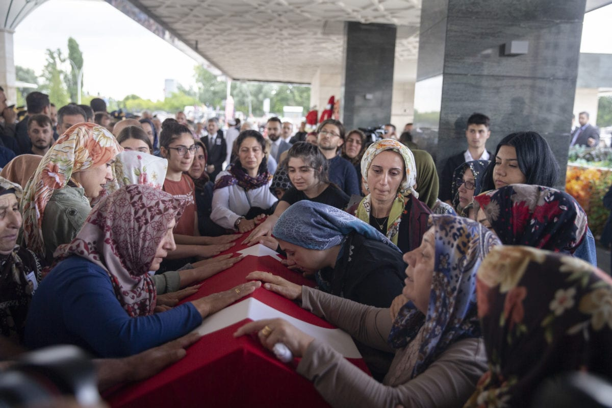 Relatives of Turkish diplomat Osman Kose, who was martyred in an armed attack in Iraq's Erbil, mourn during his funeral ceremony at Ahmet Hamdi Akseki Mosque in Ankara, Turkey on July 18, 2019. [Emin Sansar - Anadolu Agency]