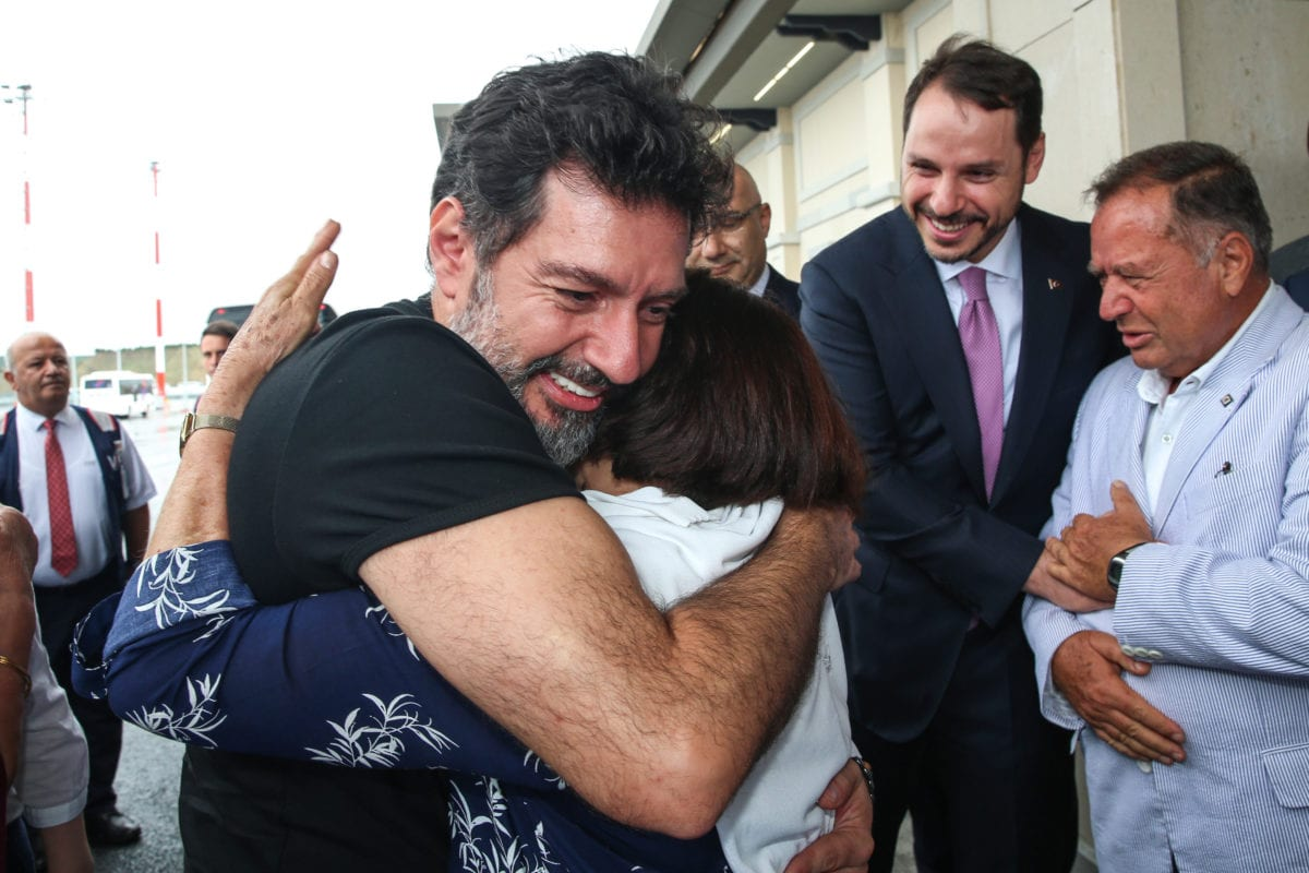 A former Turkish banking executive Mehmet Hakan Atilla (Front L), who was released from a federal US prison last week, is welcomed by a relative after arriving at Istanbul Airport in Istanbul, Turkey on 24 July 2019. [Muhammed Enes Yıldırım - Anadolu Agency]