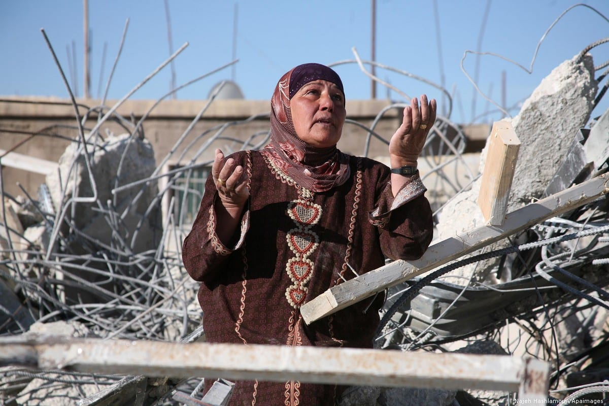A Palestinian woman is seen near the rubble of her family house after it was destroyed by the Israeli army. The house was located in the so-called Area C [Najeh Hashlamoun/Apaimages]