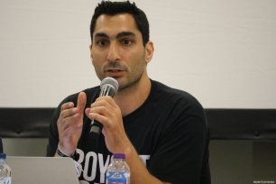 Remi Kanazi, an American-Palestinian spoken word artist, speaks at the Palestine Expo 2019 on 6 July 2019 in London, UK [Middle East Monitor]