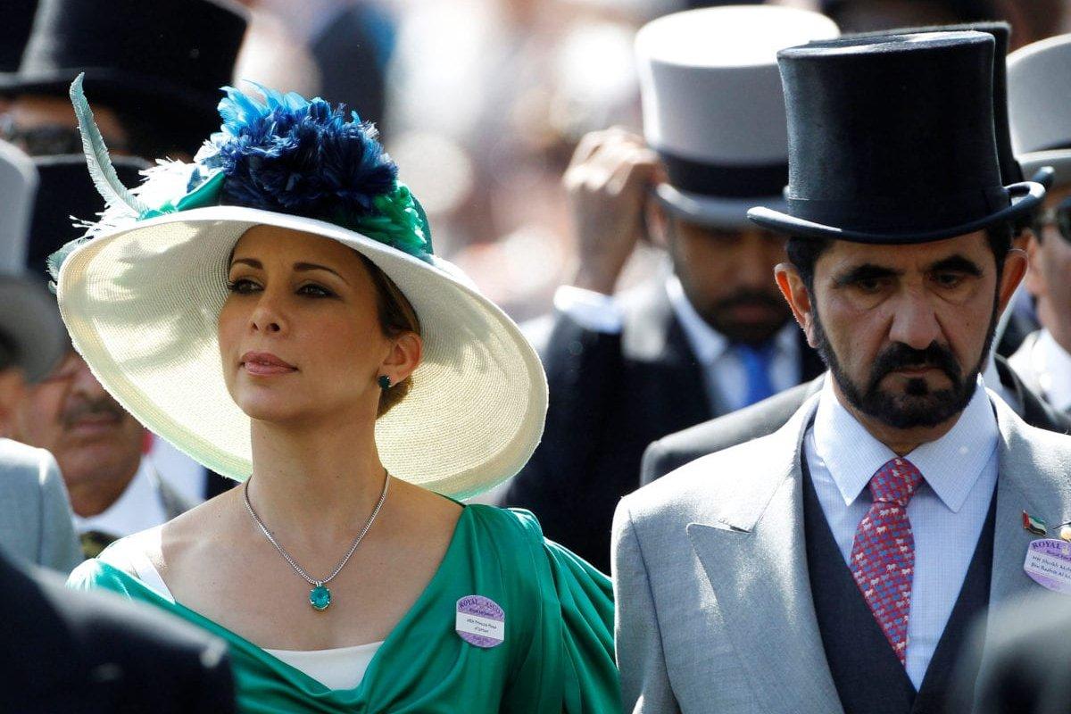 Jordanian Princess Haya bint Al-Hussein and her husband, Dubai ruler Sheikh Mohammed bin Rashid al-Maktoum (R), walk to the parade ring on Ladies Day, the third day of horse racing at Royal Ascot in southern England on 17 June 2010. [REUTERS]