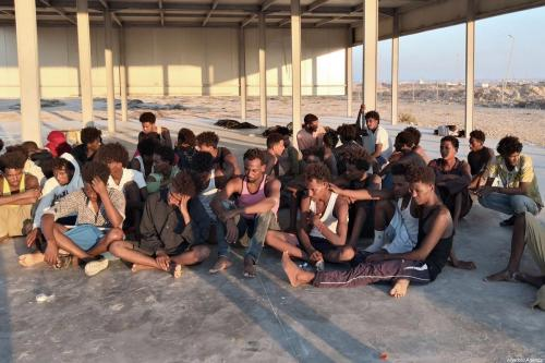 A group of irregular migrants, rescued by Libyan Coastal Guard, wait after a boat sank off the city of Al-Khoms, Libya 5 miles from the coast on 25 July 2019. [Hazem Turkia - Anadolu Agency]