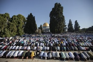 Muslims perform the Eid Al Adha (Feast of Sacrifice) prayer at Al-Aqsa Mosque in Jerusalem on 11 August 2019 [Faiz Abu Rmeleh/Anadolu Agency]