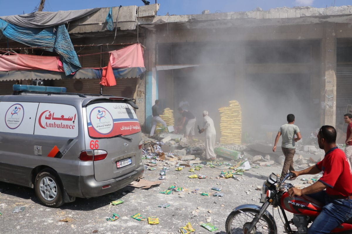 An ambulance arrives at the scene after airstrikes of Russia and Assad Regime hit Saraqib district in the de-escalation zone of Idlib, Syria on 21 August 2019. [Hüseyin Fazıl - Anadolu Agency]