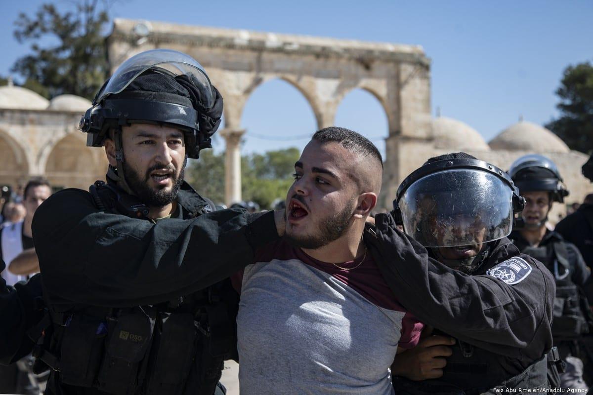 Israeli forces attack Palestinian worshippers in Jerusalem's Al-Aqsa mosque on 11 August 2019 [Faiz Abu Rmeleh/Anadolu Agency]