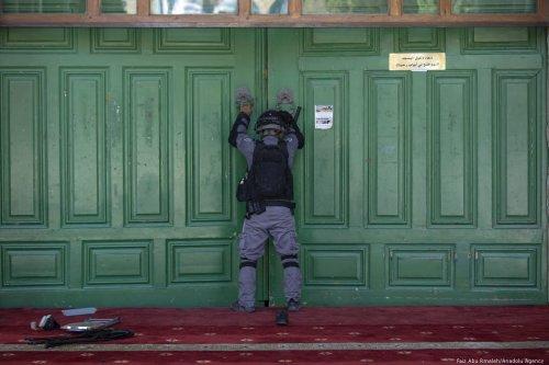 Israeli forces block the doors of Al-Aqsa mosque complex on 11 August 2019 [Faiz Abu Rmeleh/Anadolu Agency]