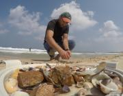 Palestinian Kamal Al-Madhoun collects seashells to use them to decorate pottery in Gaza [Mohammed Asad/Middle East Monitor]