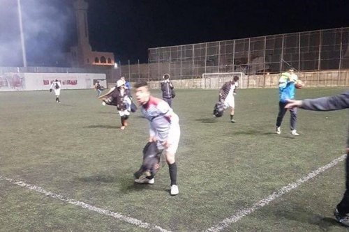 Palestinian players forced to leave the field after an Israeli tear gas attack January 2019