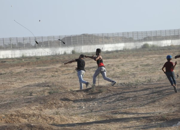 Palestinians converged near a fence between the Gaza Strip and Israel to demonstrate against Tel Aviv's decades-long occupation of Palestinian territories on Friday 30 August 2019 at the Gaza separation fence. [Mohammed Asad/Middle East Monitor]