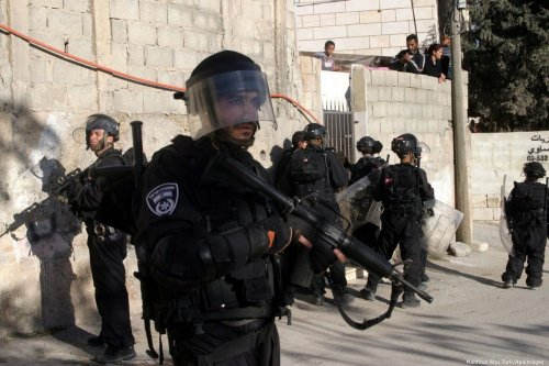 Israeli soldiers stand guard in Issawiya, East Jerusalem on 19 December 2012 [Mahfouz Abu Turk/Apaimages]