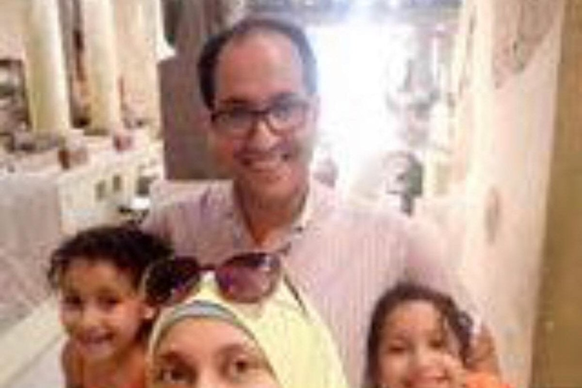 Disappeared journalist and former detainee Hassan El-Kabany with his wife Aya Alaa and two daughters [Twitter]