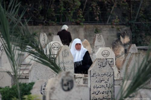 Palestinian women visit loved ones in a cemetery in the West Bank City of Nablus on 15 October 2013 [Nedal Eshtayah/Apaimages]