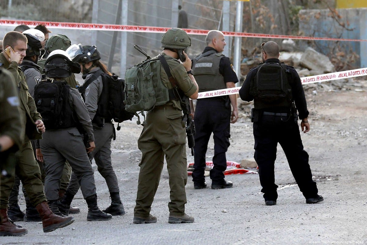 Israeli soldiers gather at the scene where a Palestinian was shot dead near a check point in the the West Bank city of Hebron on 3 September 2018 [Wisam Hashlamoun/Apaimages]