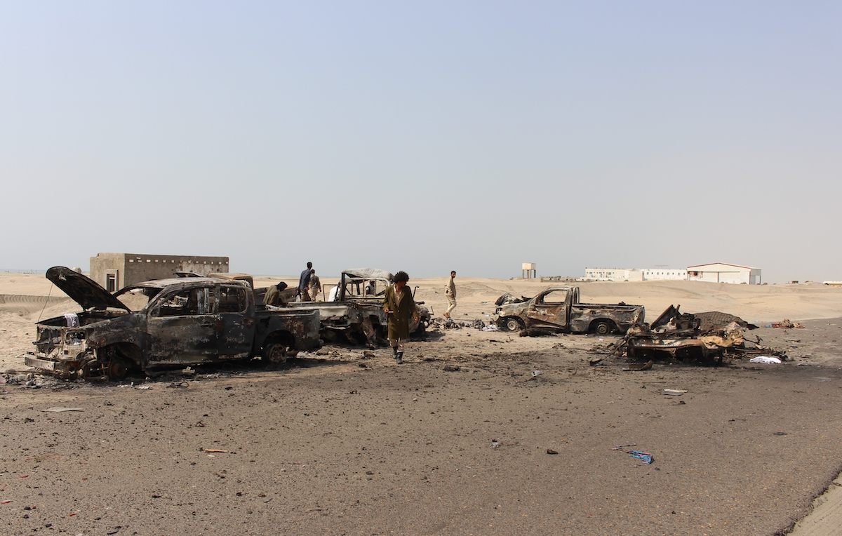 Yemeni fighters inspect burnt out vehicles as they take under control the site, reportedly belonging to pro-government troops following yesterday's air strikes by Emirati forces on Yemen's interim capital Aden, Yemen on 30 August 2019. [Wail Qubati - Anadolu Agency]