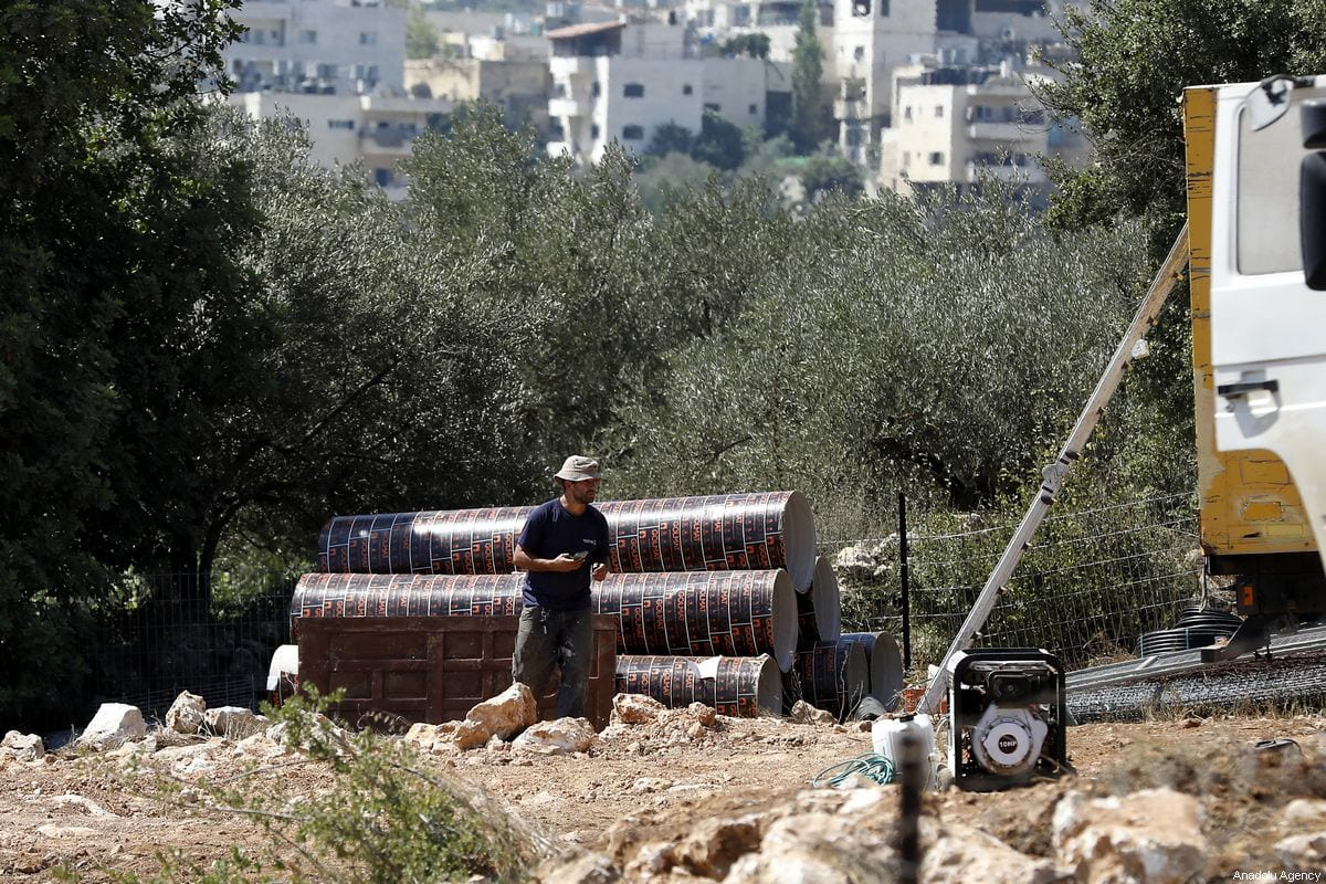 A Jewish settler is seen at an agricultural field of Palestinians' after seizing it to start an illegal construction at Beit Jala neighborhood in Bethlehem, West Bank on 3 September 2019. [ Wisam Hashlamoun - Anadolu Agency]