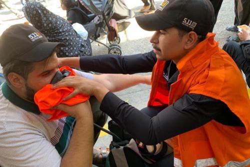 People, affected from the stampede, receives medical attention from Iraqi health team, on 10 September, 2019 in Karbala, Iraq [Stringer/Anadolu Agency]