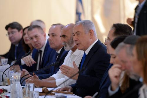 Israeli Prime Minister Benjamin Netanyahu (5th R) speaks during a cabinet meeting held in the Jordan valley, for the first time since Israel occupied the West Bank in 1967, in West Bank on 15 September 2019. [Haim Zach / GPO / Handout - Anadolu Agency]