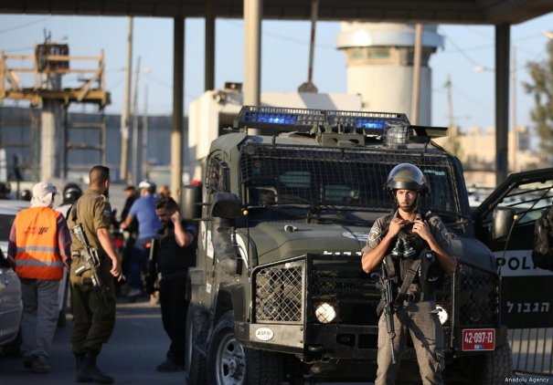 Israeli forces take security measures with blocking road, after a Palestinian woman, 50, was shot and martyred by them at the Qalandia refugee camp southern Ramallah, West Bank on 18 September, 2019 [Issam Rimawi/Anadolu Agency]