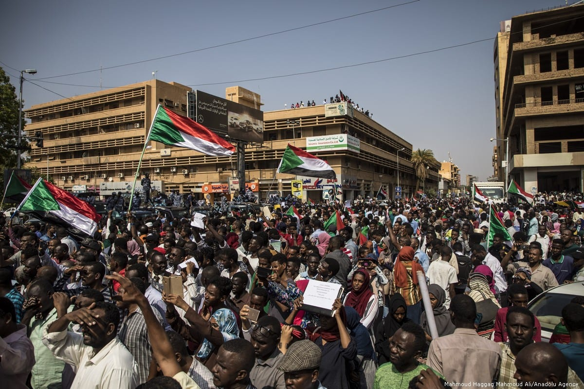 Sudanese wave Sudanese flags as they gather for a demonstration demanding a judicial reforms in Khartoum in Sudan on 12 September 2019 [Mahmoud Haggag Mahmoud Ali/Anadolu Agency]