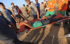 A Palestinian protester was shot by Israeli forces while demonstrating against Israel's decades-long occupation of Palestinian territories near a fence between the Gaza Strip and Israel on Friday 6 September 2019 in Gaza. [Mohammed Asad/Middle East Monitor]