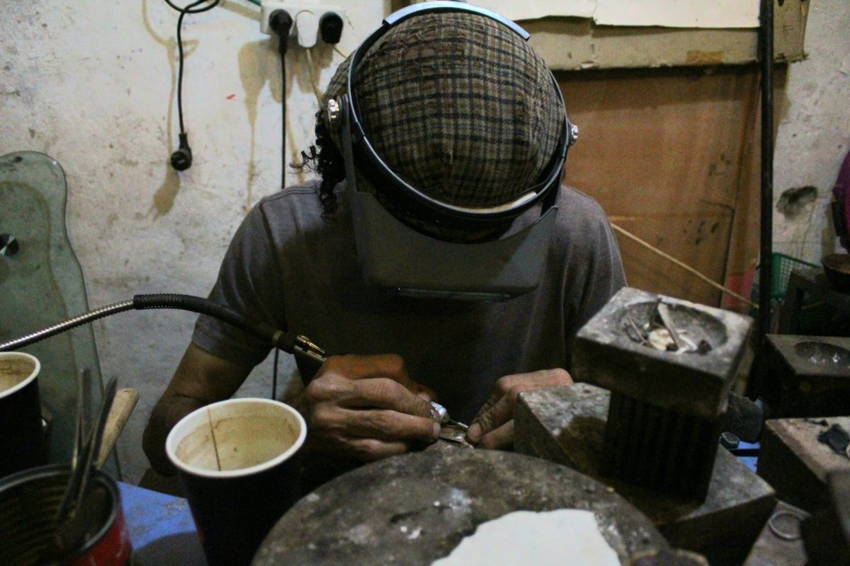 Rami Nablusi making jewelry in his shop an al-Saraya street in the Muslim quarter of the old city of Jerusalem
