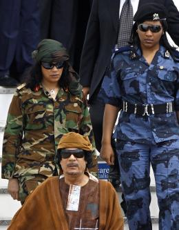 Muammar Gaddafi and his guards [Wikipedia]