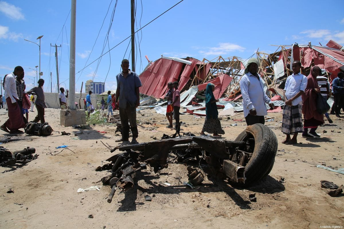 MOGADISHU, SOMALIA - SEPTEMBER 30: A wrecked vehicle part lies on the ground after Al-Qaeda affiliated al-Shabaab militants stormed the Ballidogle American special forces military base roughly 100 kilometers northwest of Mogadishu using vehicle bombs followed by sporadic gunfire from fighters in Mogadishu, Somalia on September 30, 2019. In a separate incident, al-Shabaab militants carried out an attack near Jaalle Siyad academy in Mogadishu's Hodan district targeting an EU convoy ferrying military trainers working with the Somali security forces, said a police officer. ( Sadak Mohamed - Anadolu Agency )