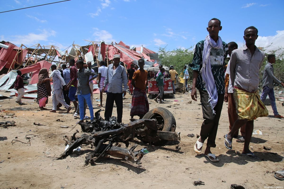 A wrecked vehicle part lies on the ground after Al-Shabaab militants set of bombs in Mogadishu, Somalia on 30 September 2019 [Sadak Mohamed/Anadolu Agency]