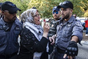Israeli forces intervene in a group of Palestinians as they gather for a demonstration in support of Palestinian prisoner Samer al-'Arbid, who was arrested by the Israeli army during a raid in the occupied West Bank city of Ramallah last week, in front of the Hadassah Hospital in Jerusalem on 1 October, 2019 [Faiz Abu Rmeleh/Anadolu Agency]