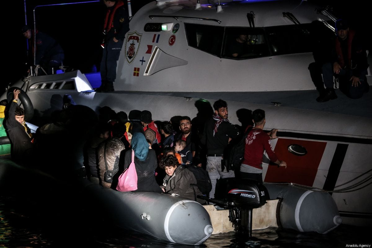 Coast guard members take 42 irregular migrants into the coast guard boat after a boat carrying irregular migrants took on water at Dikili district in Izmir, Turkey october 19, 2019. [Sergen Sezgin - Anadolu Agency]