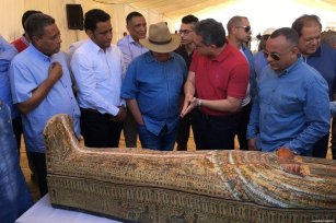 Egyptian Ministry of State for Antiquities Khaled El-Anany informs the participants on the wooden coffins, whose brightly-coloured decorations are still visible, during their publicity to press members after they were uncovered at the Theban necropolis of Asasif in Luxor, Egypt on October 19, 2019 [EGYPT'S MINISTRY OF ANTIQUITIES / HANDOUT - Anadolu Agency]