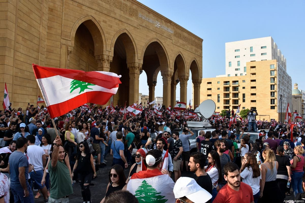 Lebanese demonstrators gather at Martyrs' Square and Riad Al Solh Square during an anti-government protest against dire economic conditions and new tax regulations on messaging services like Whatsapp, in Beirut, Lebanon on 19 October 2019. [ Mahmut Geldi - Anadolu Agency ]