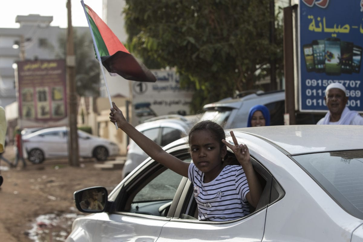 A group of people stage a demonstration call for the disbanding of Sudan's former ruling National Congress Party (NCP), which was headed by ousted President Omar al-Bashir, on 21 October, 2019 in Khartoum, Sudan [Mahmoud Hajaj/Anadolu Agency]