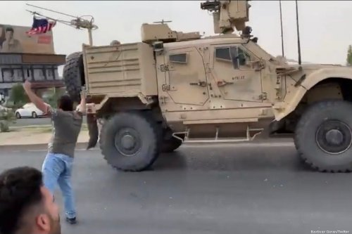 People throw stones at the US convoy as they pass through Erbil, Iraq on 21 October 2019 [Baxtiyar Goran/Twitter]