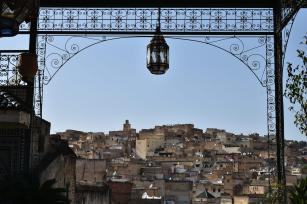 View over the rooftops of the ancient city of Fes, Morocco, from a high ornamented terrace situated in the city's Old Medina