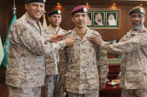 Former Saudi Brigadier General Musa Bin Dhaher Al-Balawi (C)
