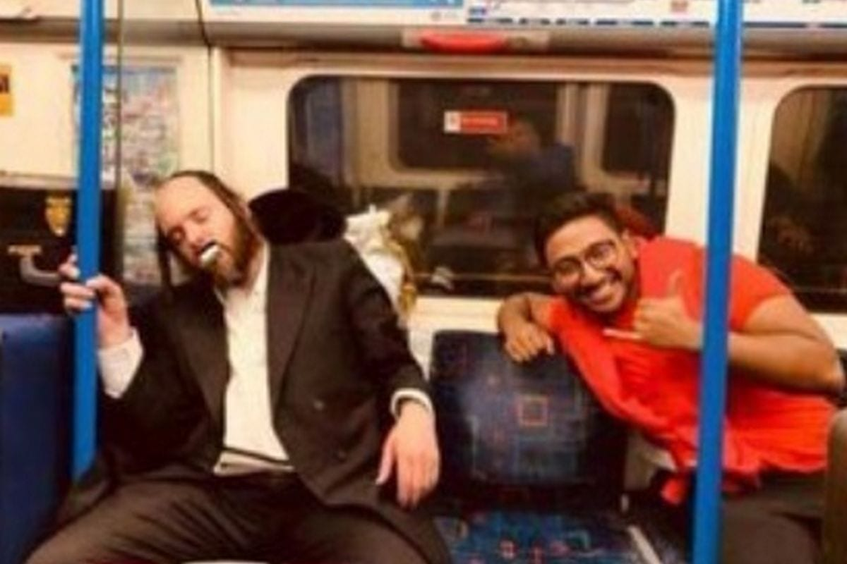 A UK student took a selfie with an Orthodox Jewish man, who was sleeping on a train, after placing a Palestinian flag over his mouth.