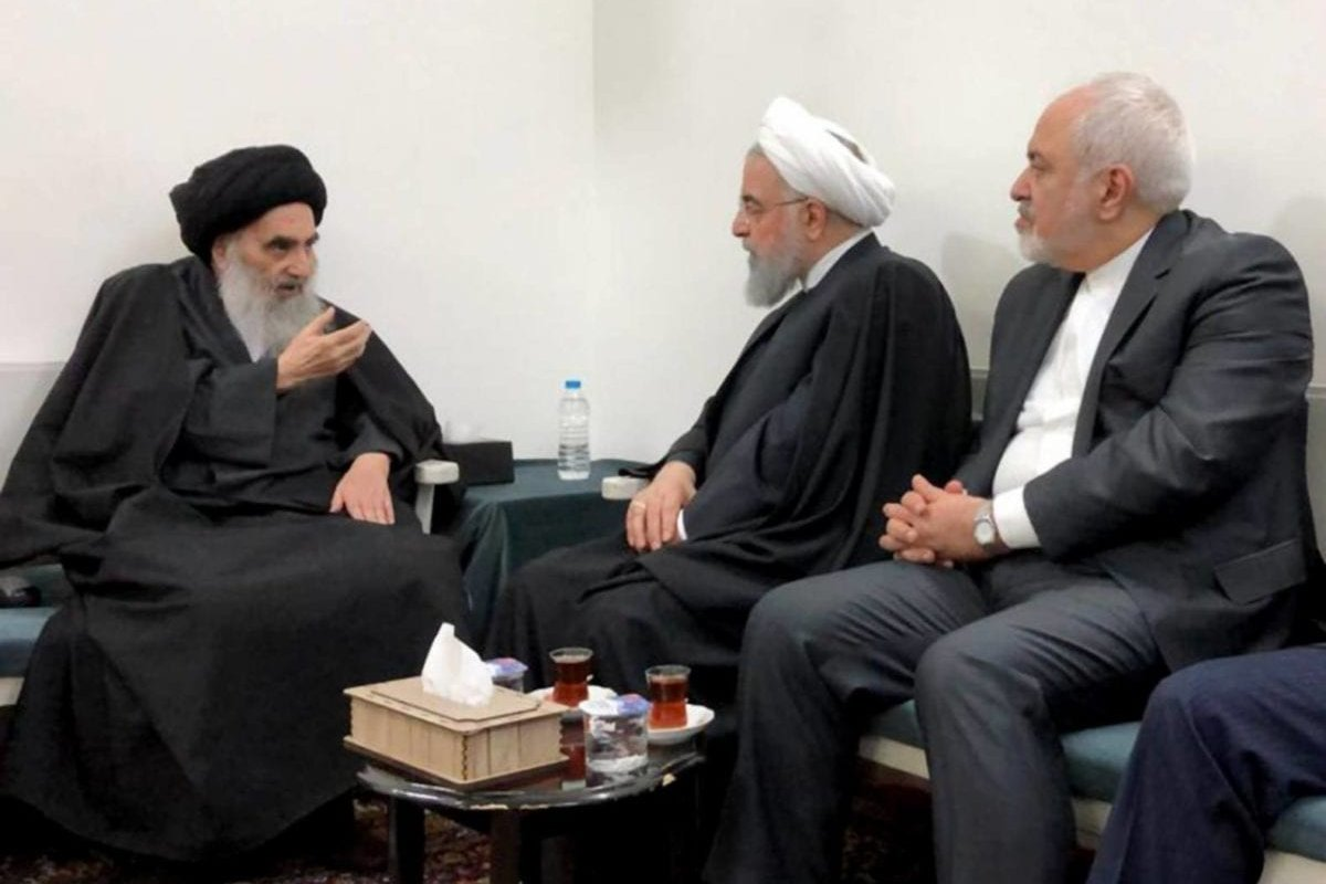 Iranian President Hassan Rouhani (2L) meets with Shia cleric Ali al-Sistani (L) as part of his current visit to Iraq, on 13 March 2019 in Najaf, Iraq. [Ayatollah Ali al-Sistani's Office / Handout - Anadolu Agency]