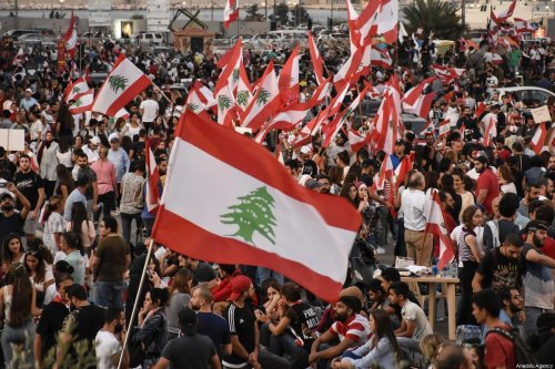 Demonstrators gather to stage a protest against the government's policy on easing the economical crisis in Beirut, Lebanon on October 22, 2019 [Mahmut Geldi / Anadolu Agency]