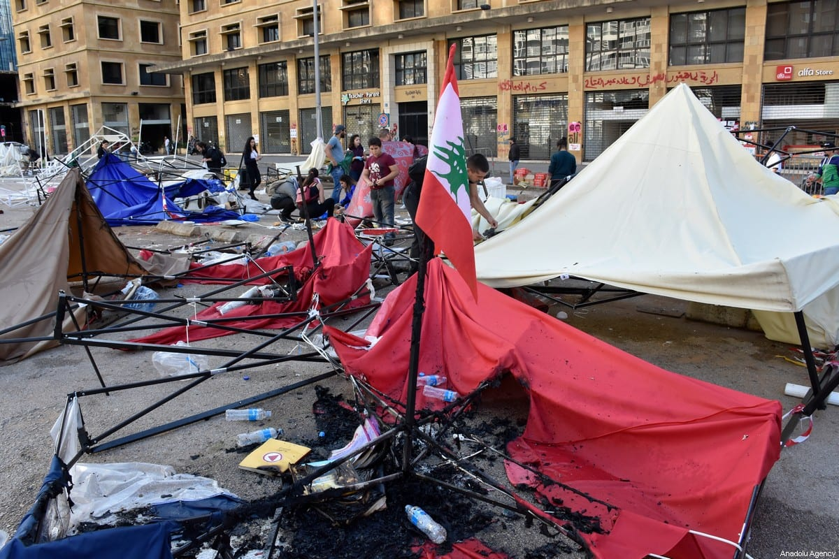 Tents of anti-government protesters are damaged after their camp was attacked by supporters of Lebanese Shia groups Hezbollah and Amal movement during ongoing anti-government protest in Beirut, Lebanon on 29 October 2019. [Mahmut Geldi - Anadolu Agency]